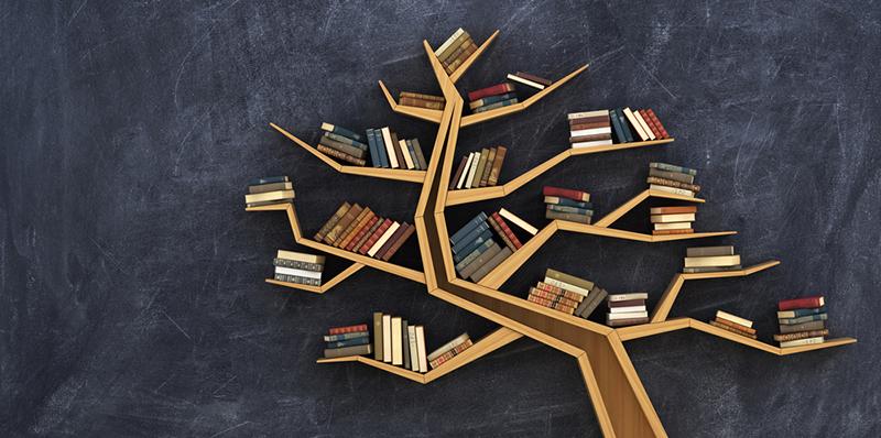 kirjoja puun oksilla