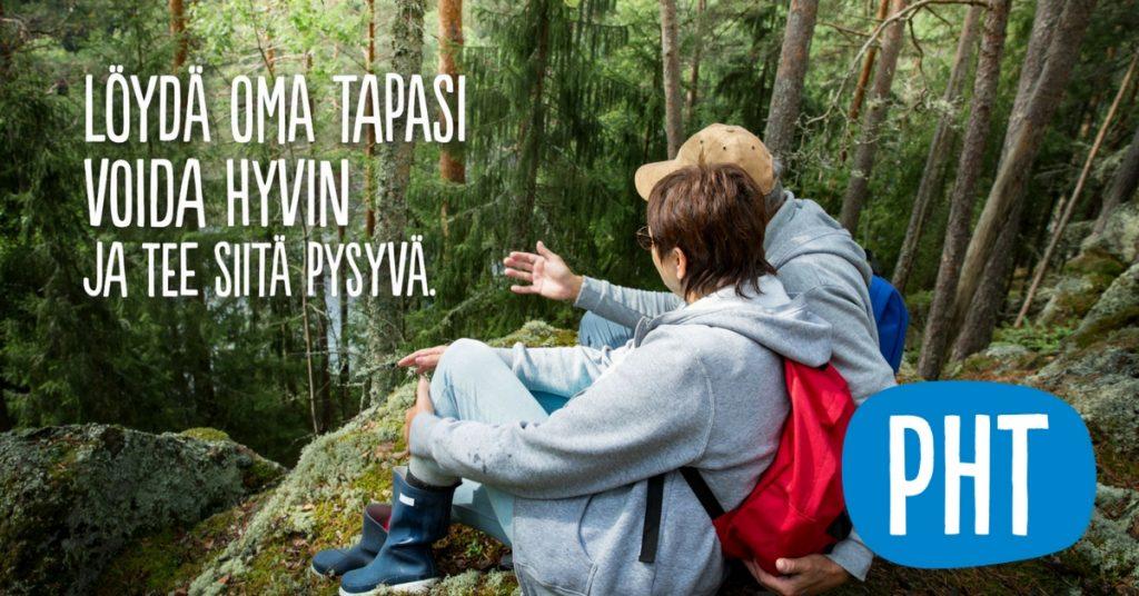 PHT:n mainos, jossa kaksi ihmistä on metsässä